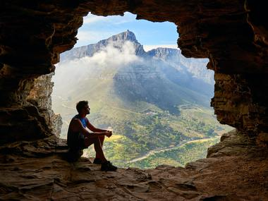 Photo Of Man Sitting On A Cave 1659437
